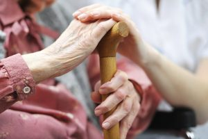Nursing-home-holding-hands-300x200